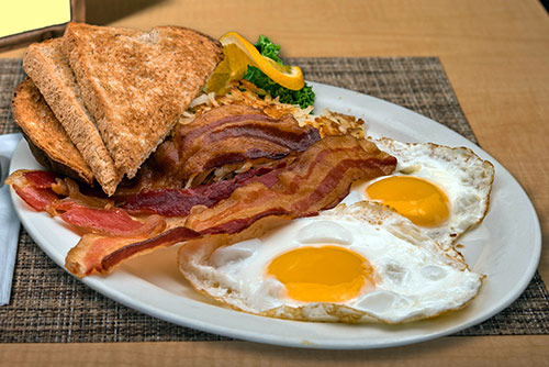 two eggs with bacon sausage or ham breakfast